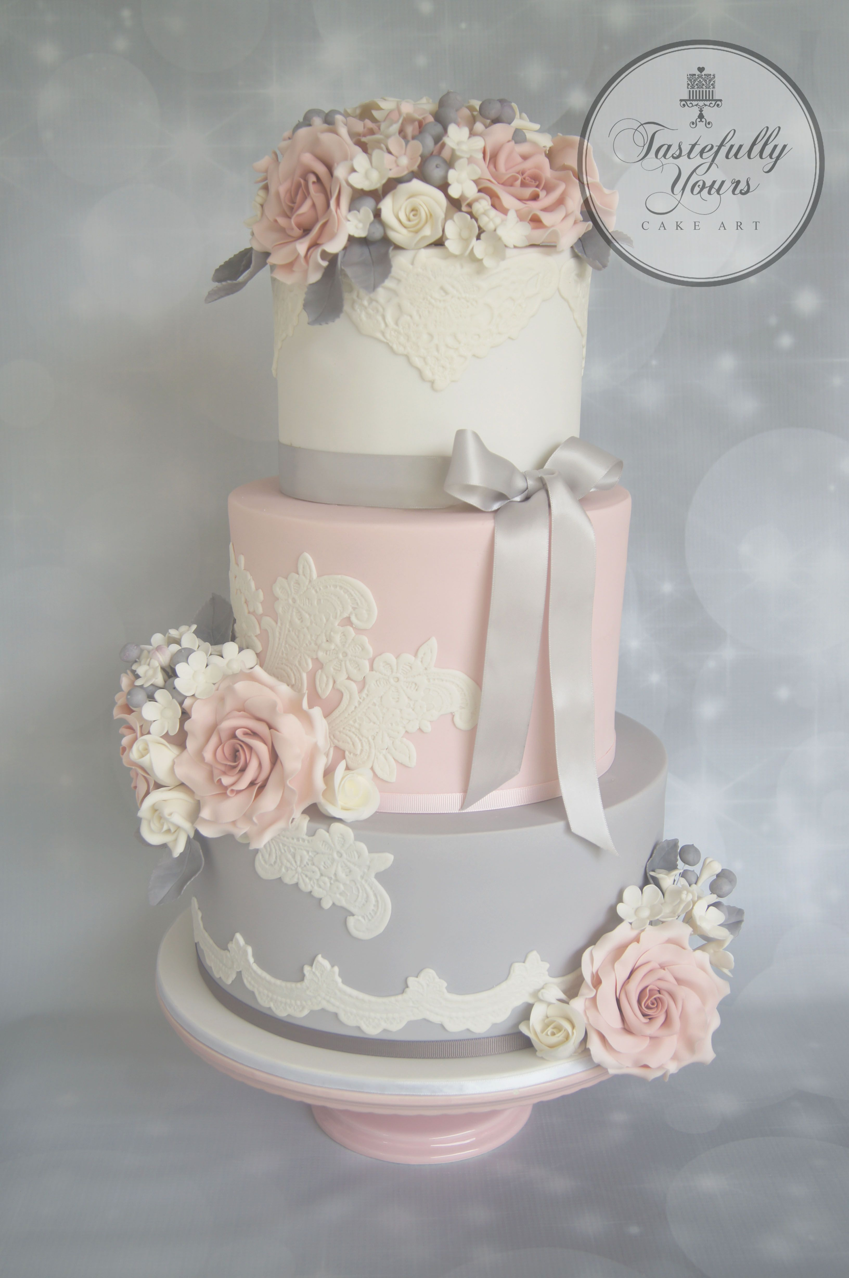 Wedding cake with lace in pink, white and grey with sugarflowers by ...
