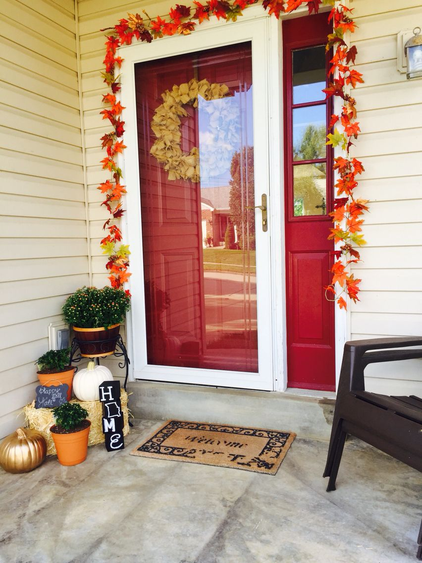 Fall front porch fake pumpkins one spray painted gold mums a