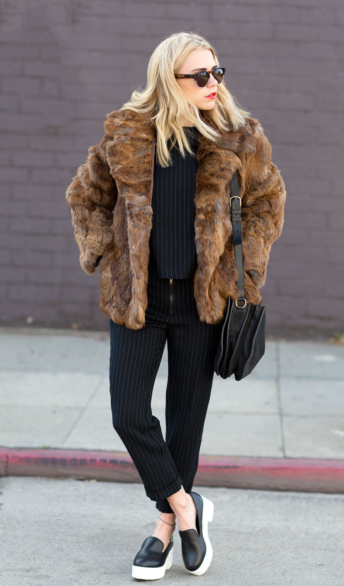 Courtney Trop of Always Judging wears a vintage coat; LNA top and pants; YSL bag; Shellys London Lacharite Shoes.