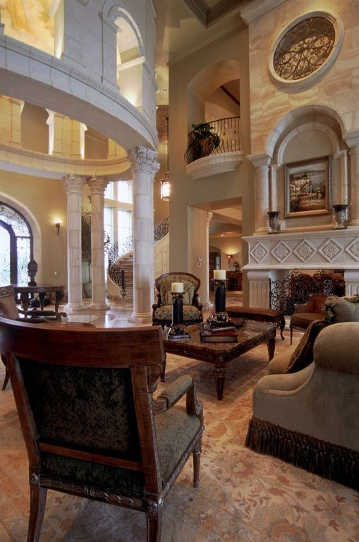 Mediterranean Living Room With High Ceiling Carpet Fireplace
