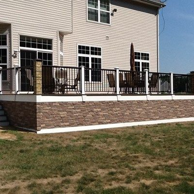 This Deck Has Trex Decking With A Faux Stone Skirt By Exteria And