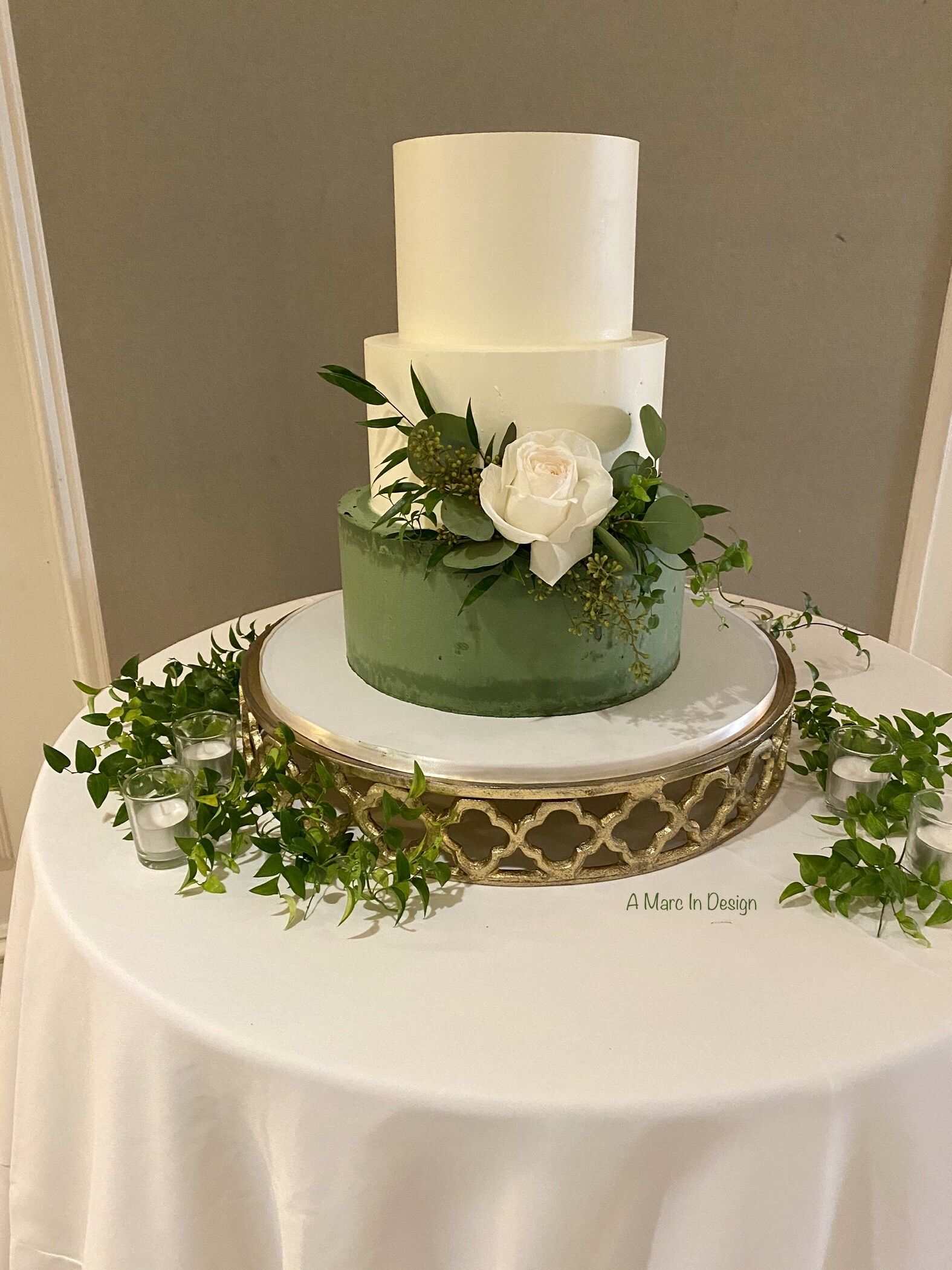 Fragrant eucalyptus and white rose adorn this cake in 2020