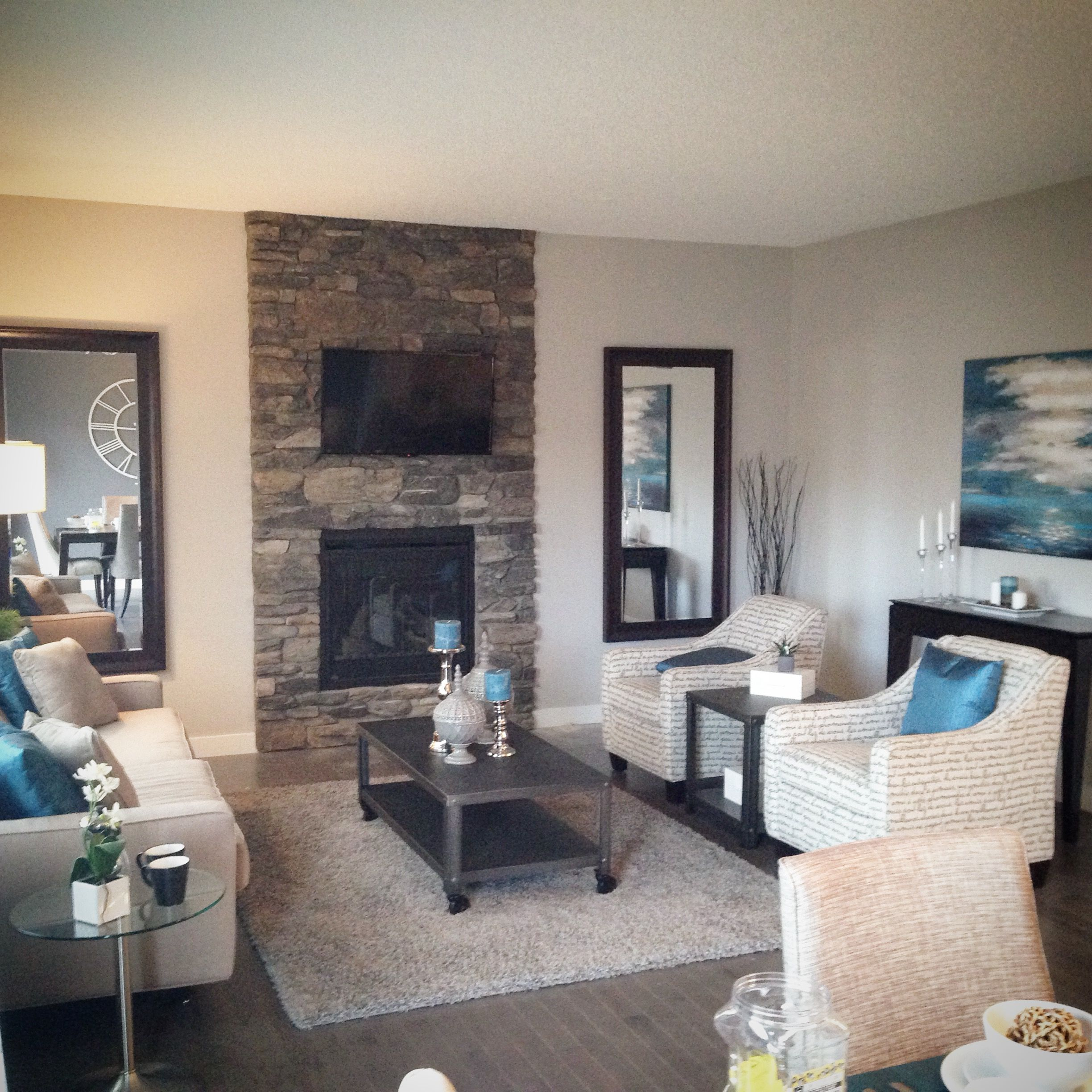 living room greatroom decor design with teal blue accents and