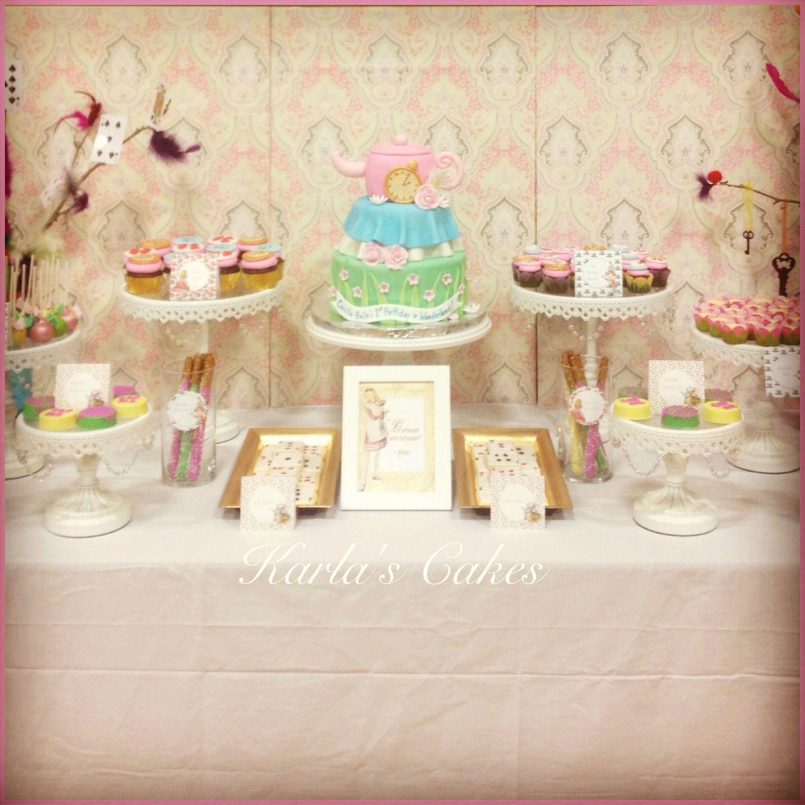 vintage alice in wonderland themed first birthday dessert table