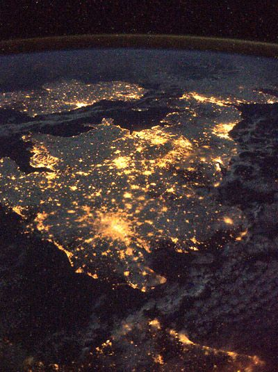 the UK and Ireland at night with huge areas twinkling