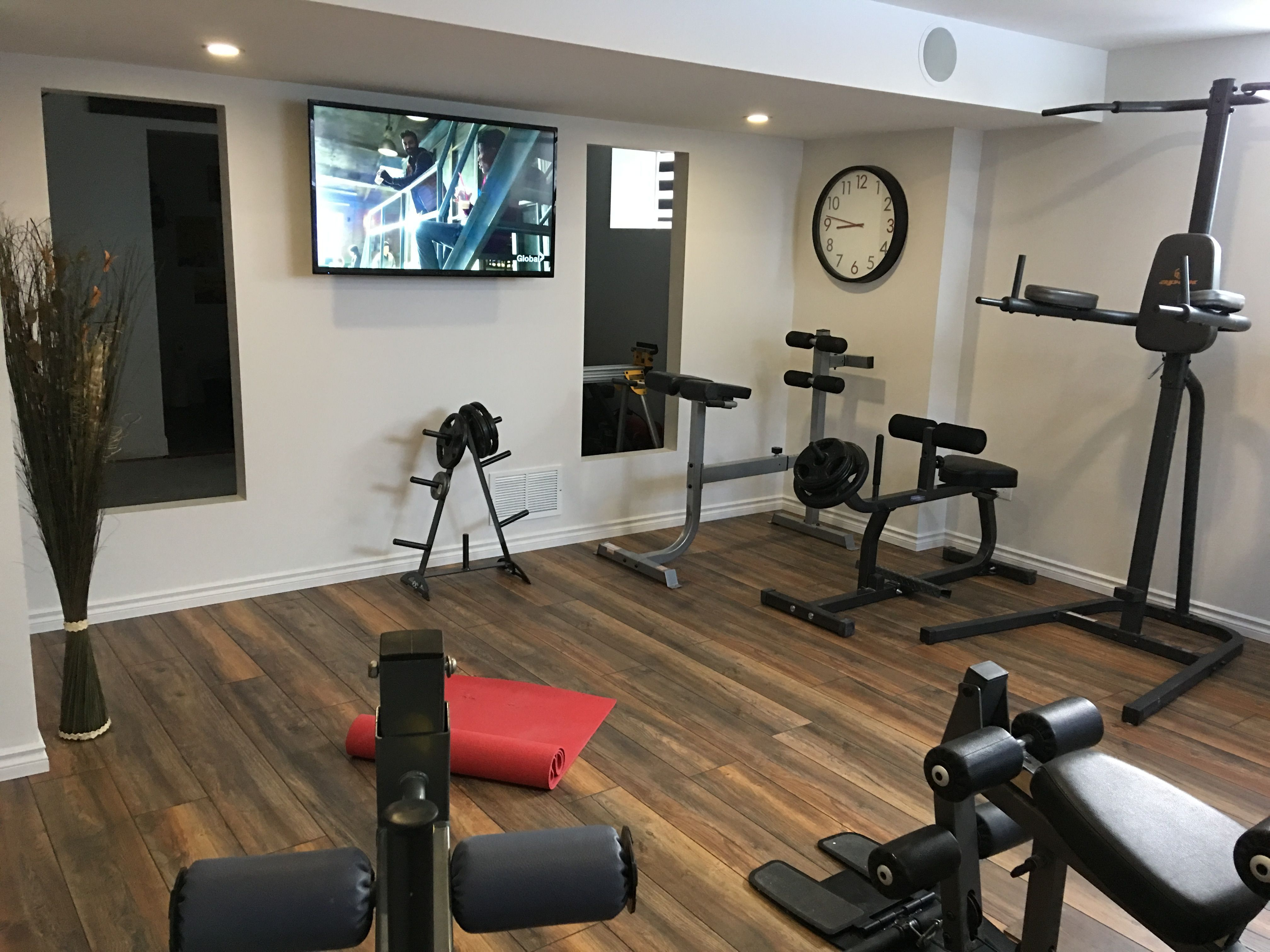 New Flooring Added A Couple Of Hours To Install A Beautiful Laminate Flooring Gym Room At Home Home Gym Decor Basement Makeover