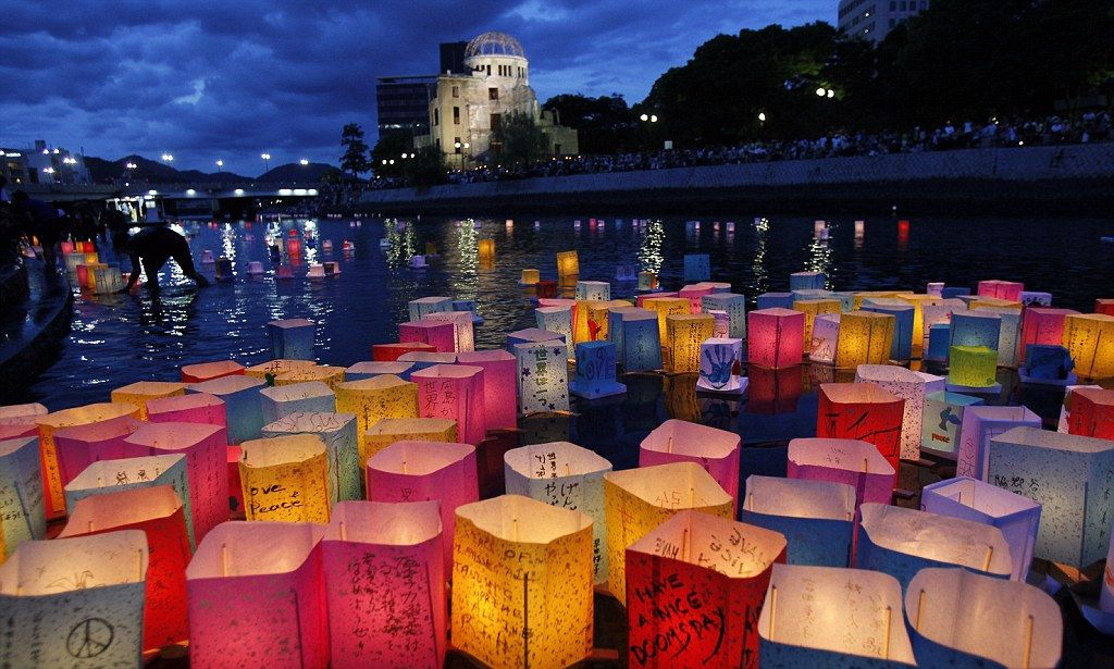 Lanterns for 140,000 'spirits': Hiroshima marks anniversary of A-bomb as Japanese PM admits he 'regrets' nuclear power
