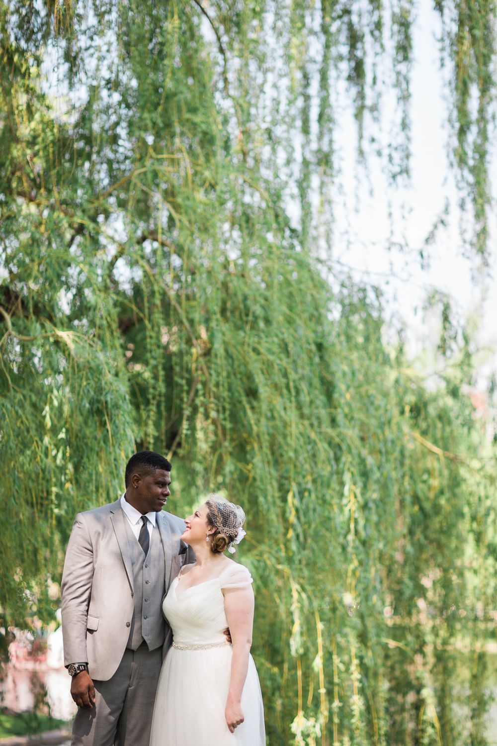What a perfect day for an elopement. The day couldn't have been any prettier when Stephanie and Sterling met with their family and friends for a sweet, romantic (and funny!) ceremony overlooking the pond. Sterling looked very dapper in his grey suit and Stephanie looked like a Victorian dream with her beautiful birdcage veil and flowers in her hair.