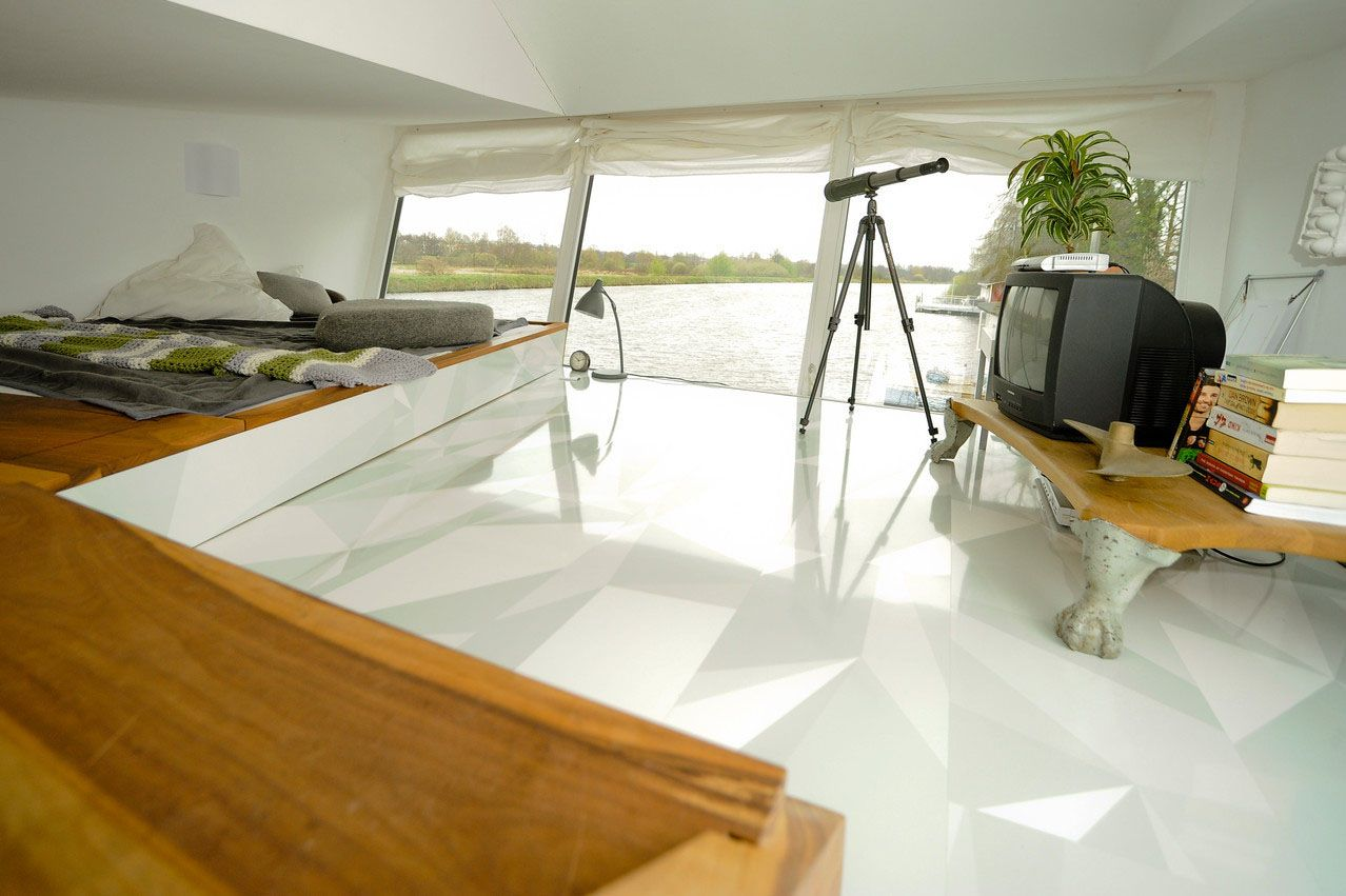 Personal minimalist luxury showcased by sascha akkermanns houseboat
