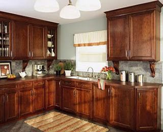 Grey Kitchen Walls With Cherry Cabinets cherry kitchen cabinets with blue/grey wall | our home decorating