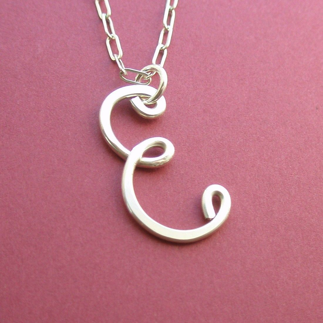 the letter e necklace all sterling silver 2500 via etsy