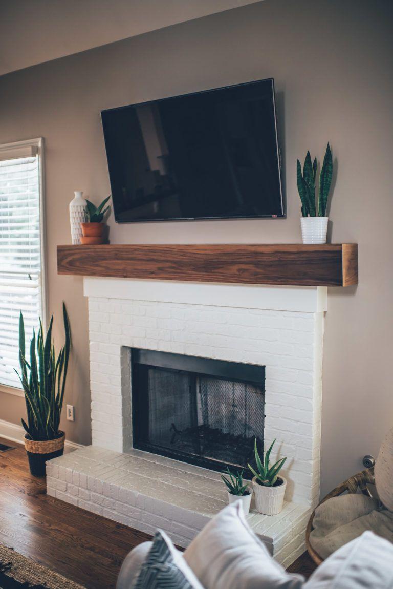 modern white brick fireplace & walnut mantel diy | white fireplace, fireplace remodel, brick