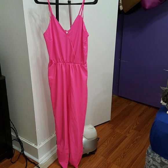 Pink romper Pink tank top romper. I didn't model because it's loose on me. My body does it no justice. It's a size Small but I'm sure it fits a medium as well depending on how loose or tight you want it. Pants Jumpsuits & Rompers