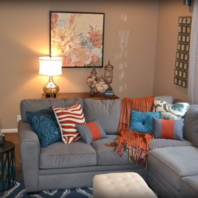 Gray orange blue family room design pinterest blue for Grey orange living room