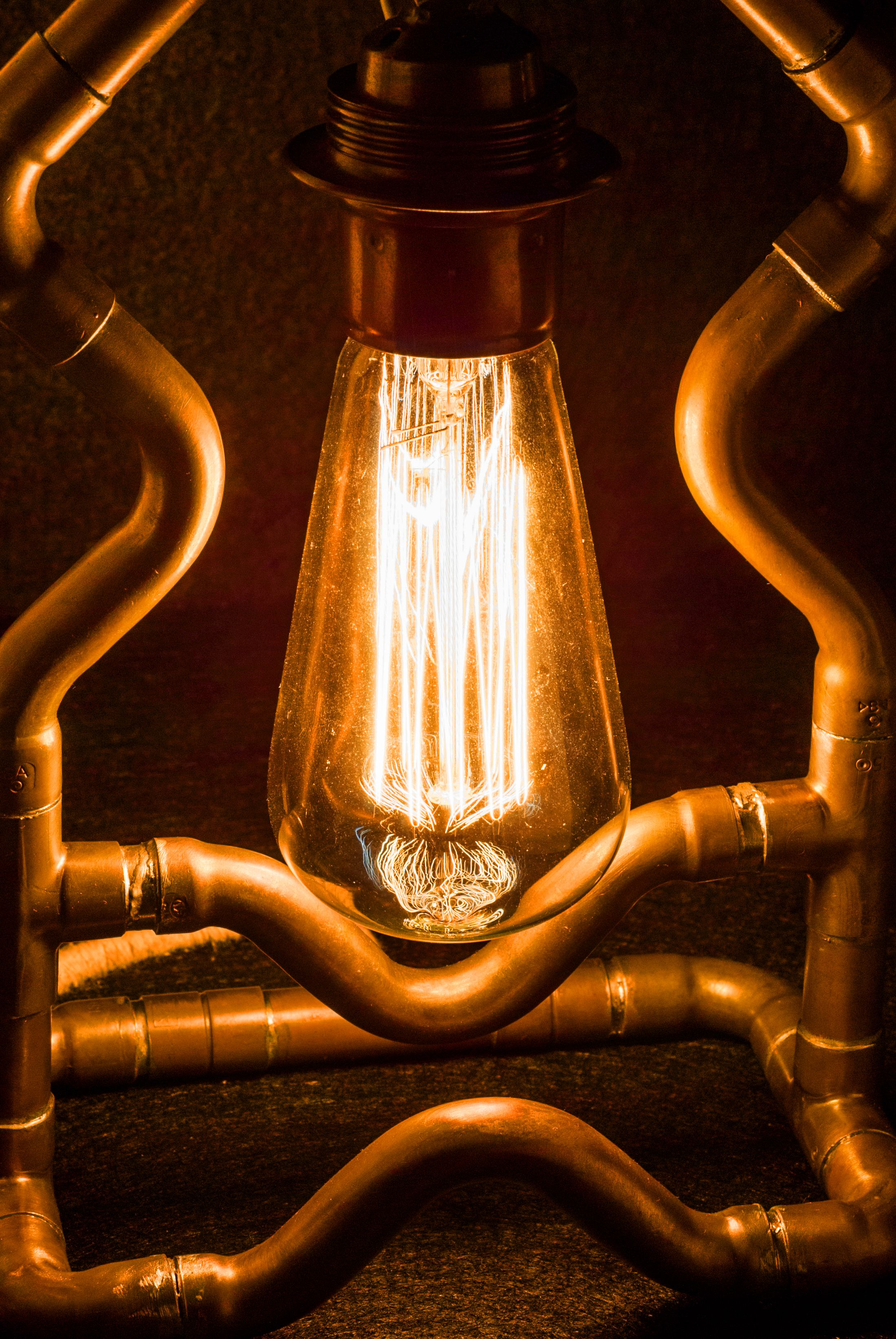 Decorative lamp made from copper pipes and Edison Light Bulb with