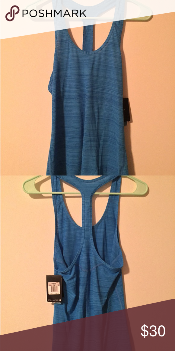 Nike tank top NWT Brand new with tags. Blue color is deep sleeves which allows for a nice open back. Nike Tops