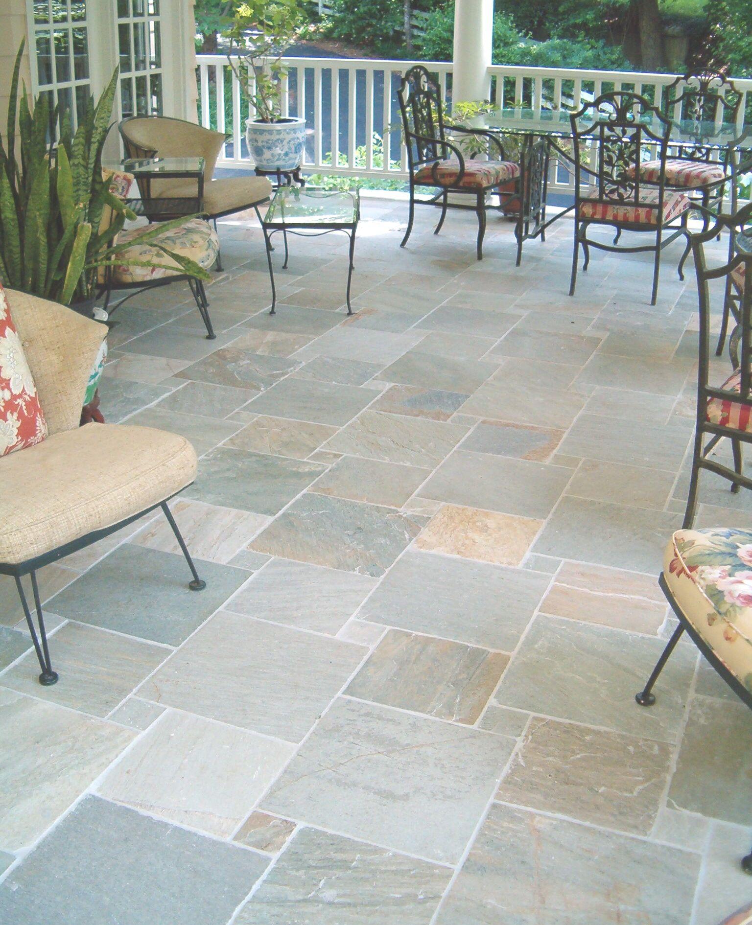 The slate tile on this allseason porch makes maintenance