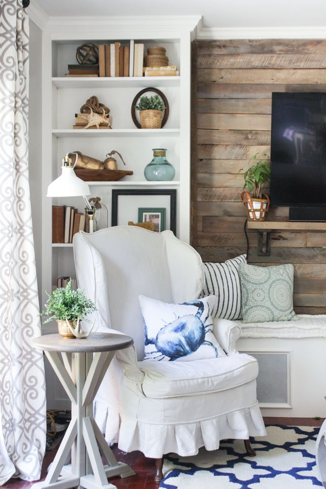 Pallet Accent Wall Built In Bookcase And Slipcovered Wing Chair