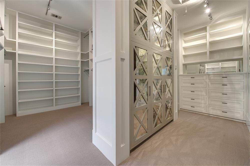 The Huge Master Closet Is Divided Into His And Her Independent Areas Featuring Built In Benches Ceiling Shelves Master Closet Master Bedroom Closet