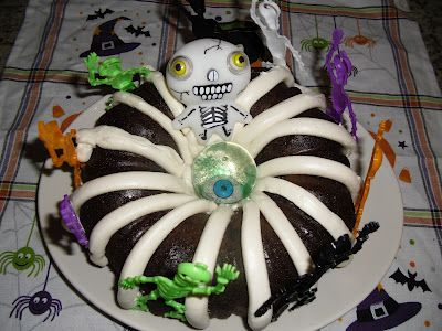 Halloween skeleton Bundt Cake! So easy with little dollar toys from - halloween decorations at walmart