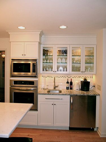 Wall Ovens And Storage For Baking Tins And Pans Are Located Near