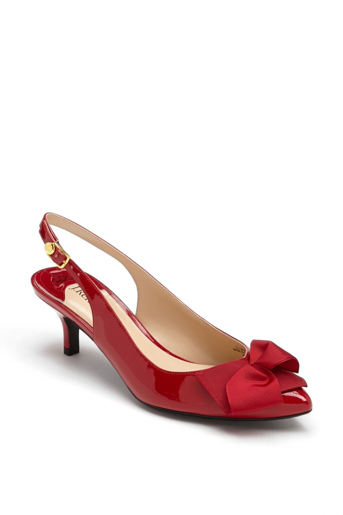 Feminine ribbon flirts at the toe of a charming slingback pump