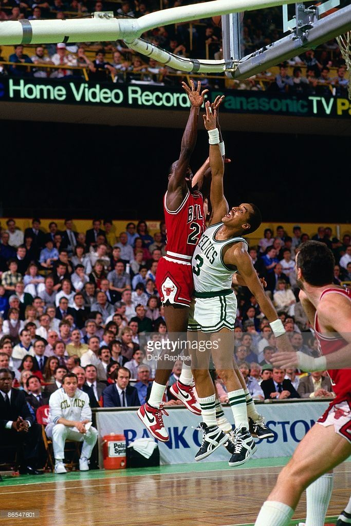 0b28529a2b1d Michael Jordan  23 of the Chicago Bulls shoots against Dennis Johnson  3 of  the Boston Celtics in Game One of the Eastern Conference Quarterfinals  during ...
