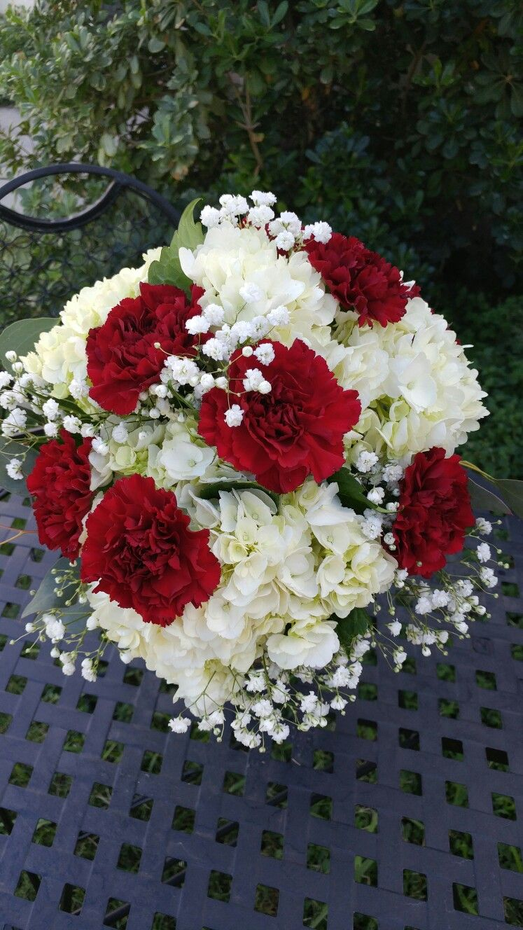 White Hydrangea Burgundy Carnations And Babies Breath