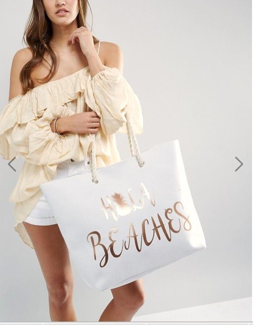 Fashion Hola Beach white tote, ruffled shirt, shorts. Great summer style, wear it with a dress, accessories. Travel advice, travel tips, trip advice, trip tips.