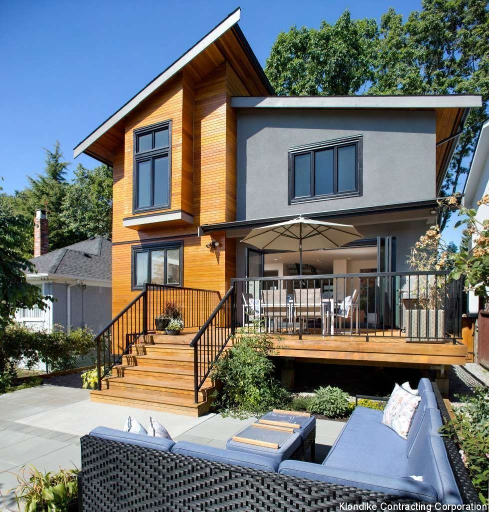 This Is A Beautiful Modern Home With A Wood Deck And Metal Railings The Wood Steps Lead To A Large Patio With Cement House Design Modern House Modern Exterior