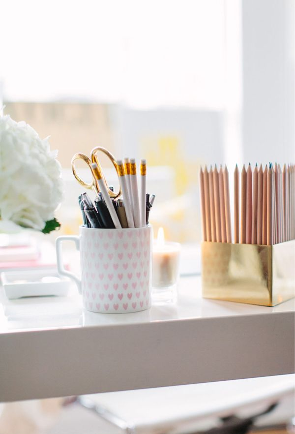 @Alaina Marie Marie Marie Kaczmarski and @Danielle Lampert Lampert Lampert Moss of The Everygirl // office space // white desk // heart mug from @elise West elm // gold pencil holder // photography by Stoffer Photography
