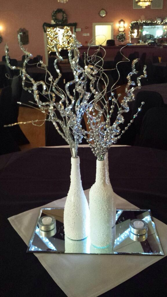 Wine bottle center piece for new years for Wine centerpiece ideas