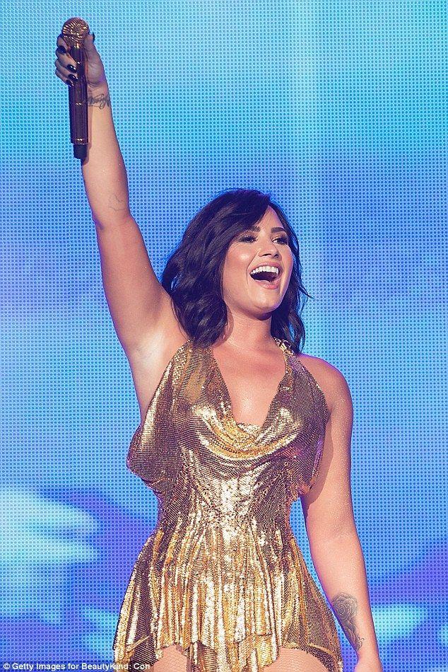 Demi Lovato Takes The Stage In Gleaming Gold Dress Demi Lovato