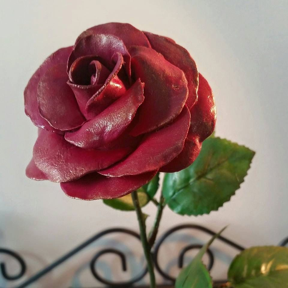 Hand sculpted air dry clay rose in a terracotta clay pot by BloominClay on Etsy