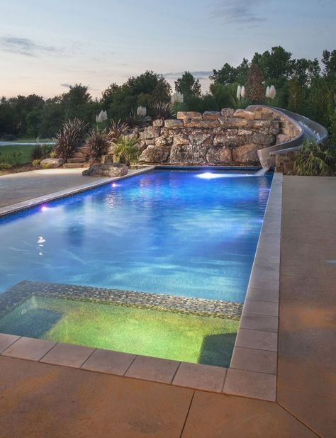 Beautiful Modern Pool With L E D Features Spill Over Spa And A Custom Rock Waterfall With A Built In Slide Luxury Swimming Pools Pool Waterfall Modern Pools