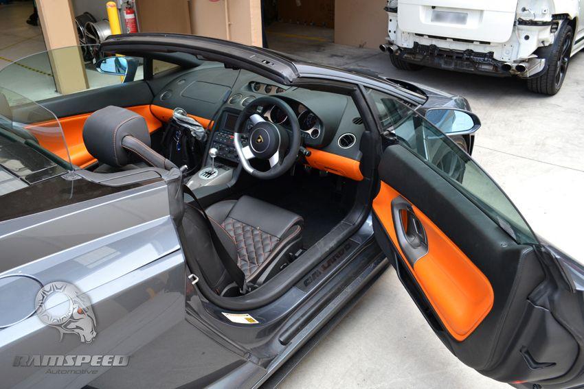lamborghini gallardo spyder interior orange with black stitching seats door panels console dash grey