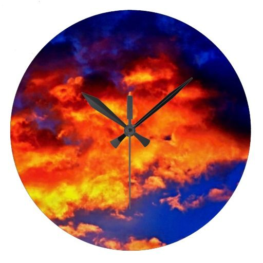 Fire in the Sky Round Wall Clock $33.95 Fire in the Sky Round Clock is photography taken of a vivid sky and clouds. The image was then worked digitally to enhance and create the fire orange and yellow color against the dark blues. It's a beautiful image and makes for a beautiful wall clock as well. Feel free to personalize with a name if you like. This clock does NOT have individual numbers.