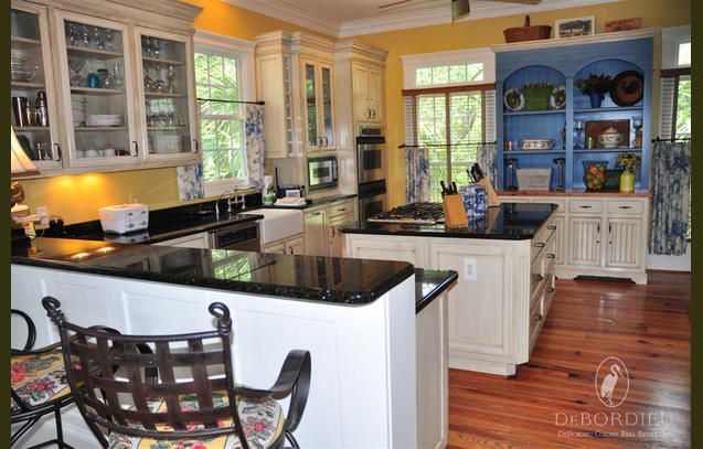 This kitchen is open to the dining and living rooms, yet still tucked away.