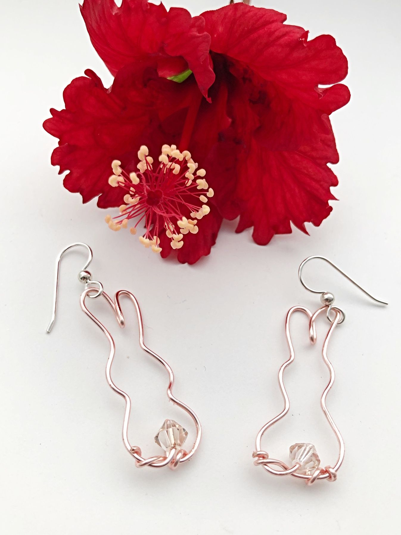 9a4f232c0 Sweet bunnies wire wrapped in rose gold artistic wire and showing off their Swarovski  crystal bunny tails!