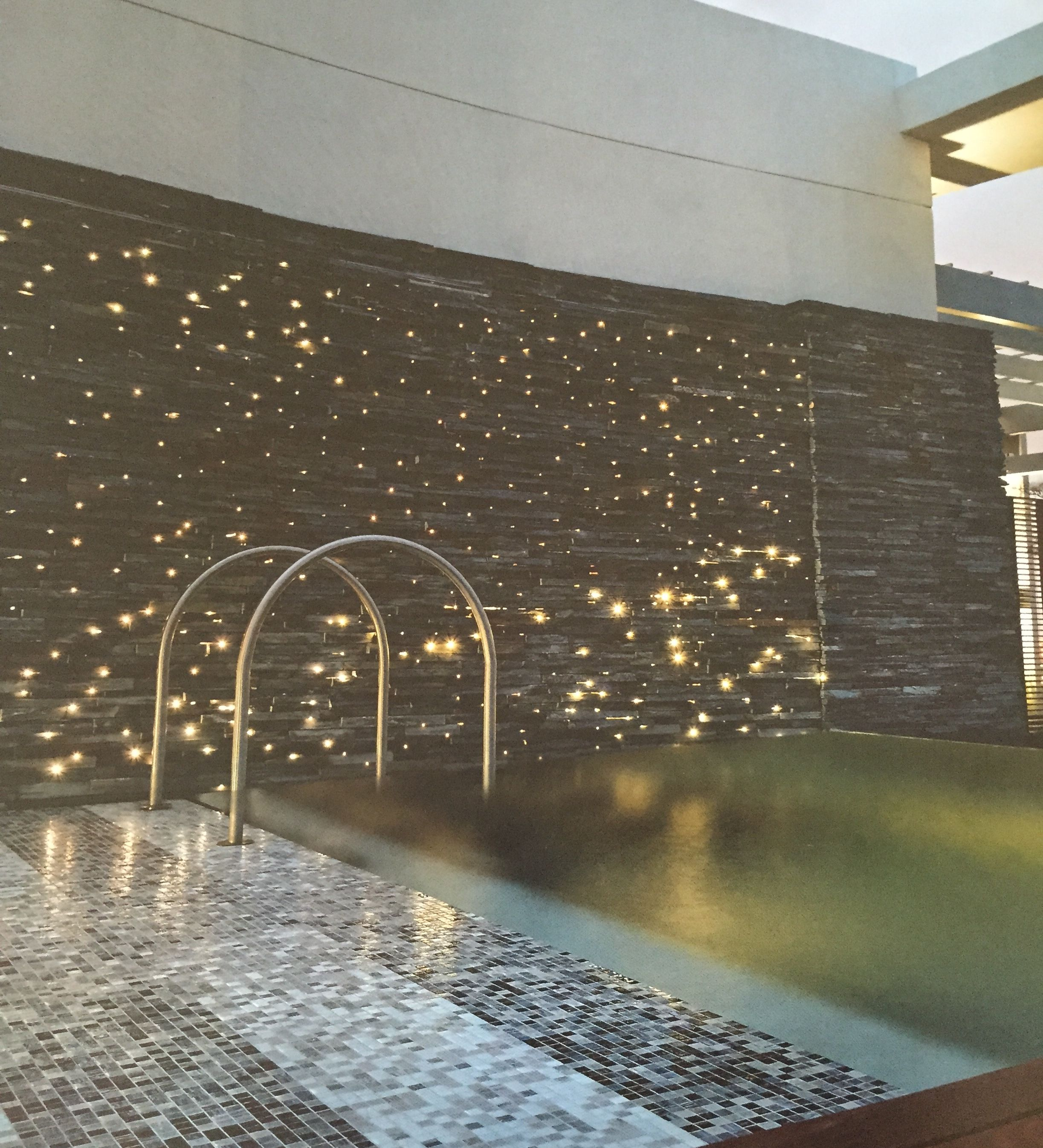 Raymond Jungles Wall is a water feature by day, light feature by night  (fiber