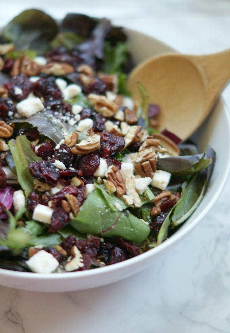 This Harvest Salad is full of fresh greens, feta cheese, cranberries, and pecans, topped with a delicious poppyseed vinaigrette. Perfect for fall dinners!