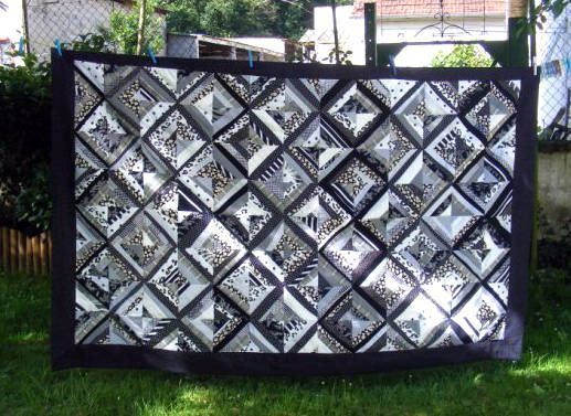 Google Image Result for http://0.tqn.com/d/quilting/1/0/8/j/-/-/Black-White-String-Quilt.jpg