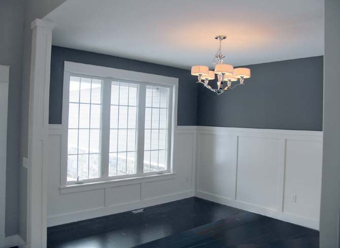 The Formal Dining Room 39 S Tall Wainscoting Is Clic. A ...