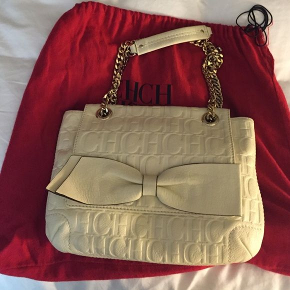 AUTHENTIC Carolina Herrera Audrey Bow Handbag Own this AMAZING white Carolina  Herrera flap bag. It 96d7ac4f50543