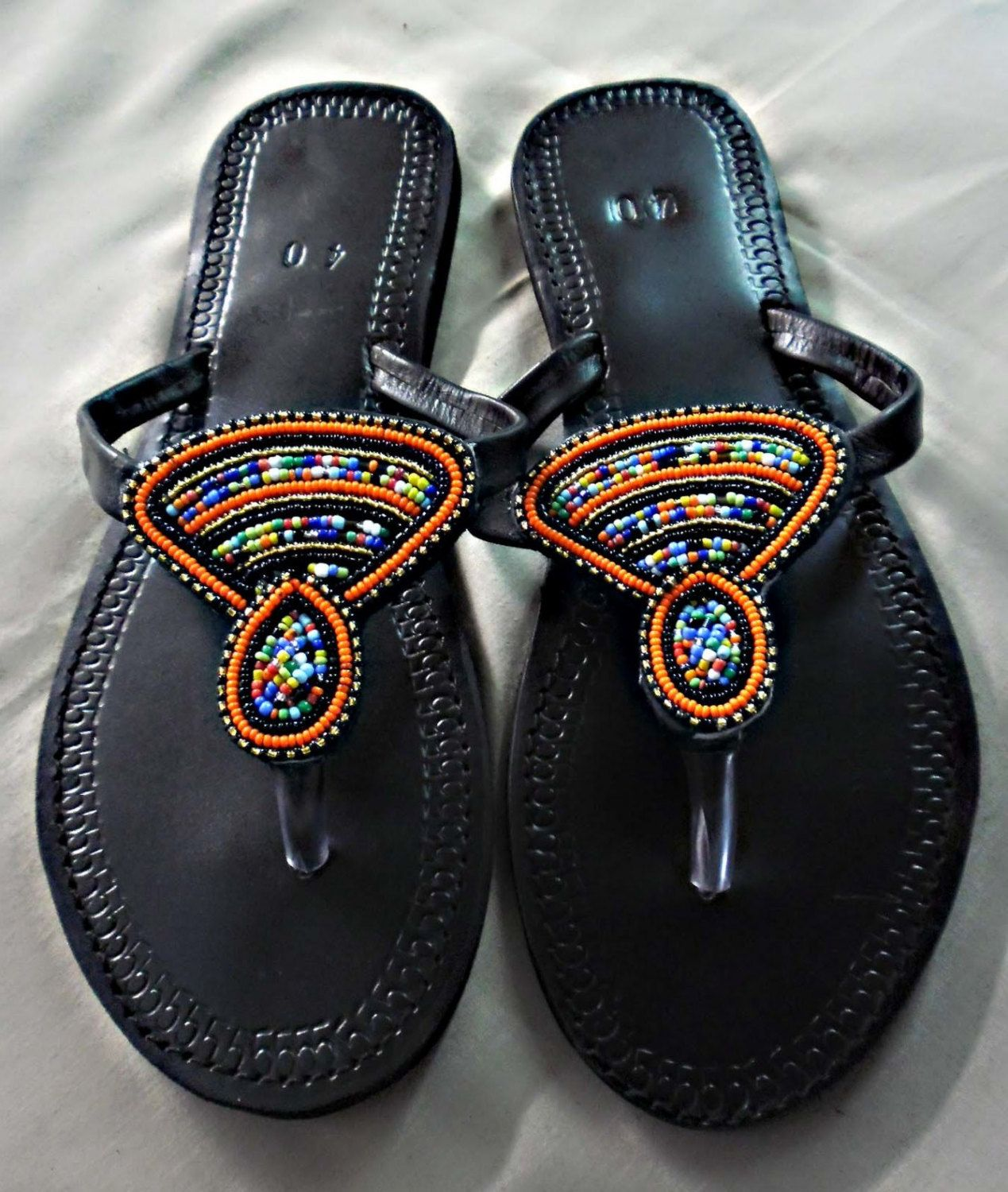 9665e3a83a27 Hand made Kenyan leather slippers with hand beaded artwork. Soft leather  straps that is very comfortable by BITSOFAFRICANCRAFTS on Etsy