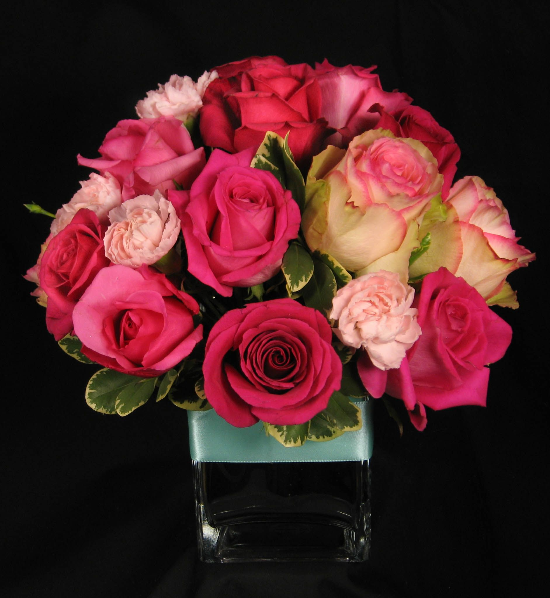 Hot pink light rose centerpiece in clear glass cube