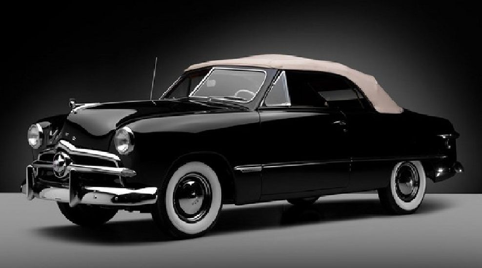 1949 ford custom black convertible, with a white soft top. | classic