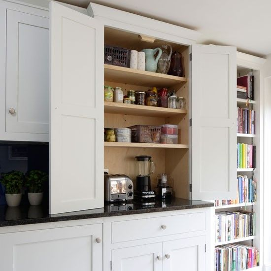 You can keep your counters clutter free by planning for an - Kitchen appliance storage cabinet ...