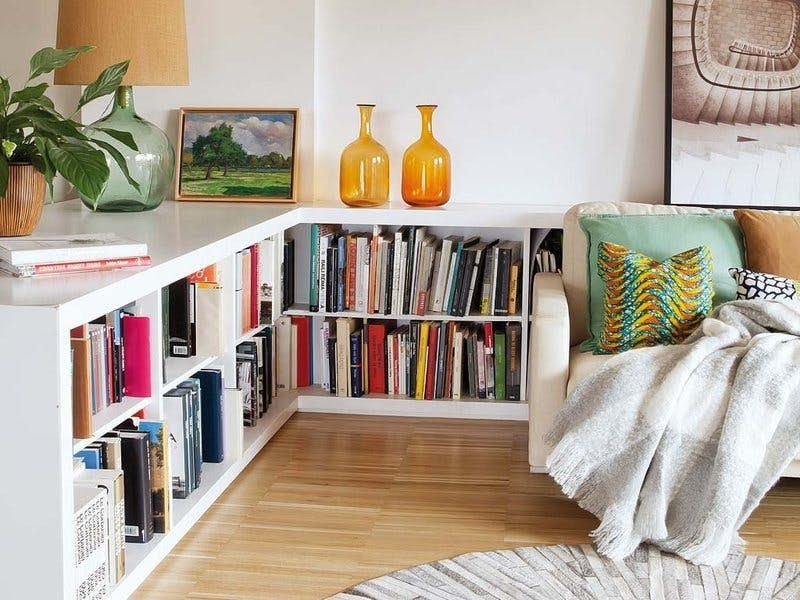 This living room from Mi Casa Revista is wrapped by waist-height bookcases, which provide quite a bit of storage with a more discreet look than a full-height bookcase. Whichever method you choose to employ, dont forget that, in a small space, the best storage solution may be right behind you. images
