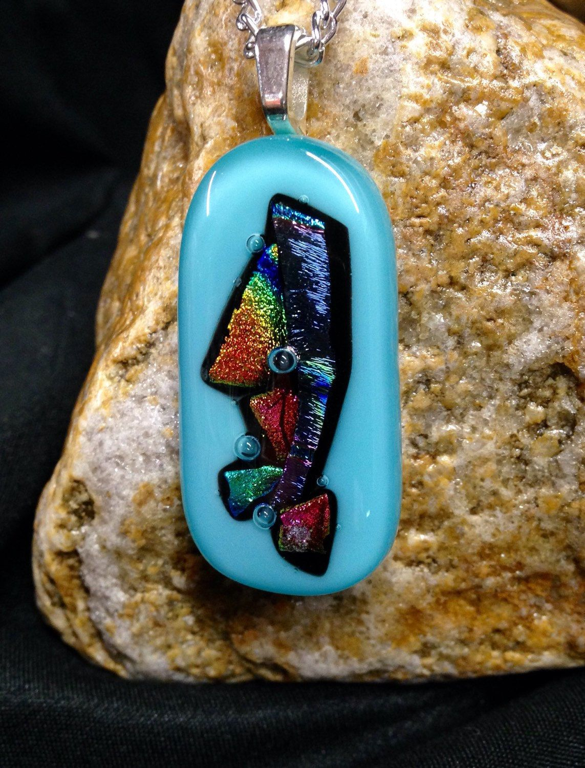 A personal favorite from my Etsy shop https://www.etsy.com/listing/281330778/dichroic-glass-pendant